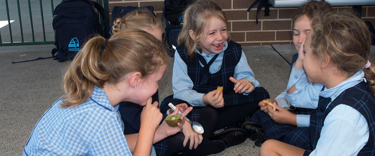 A group of MVAC primary school students laugh and enjoy crunch and sip
