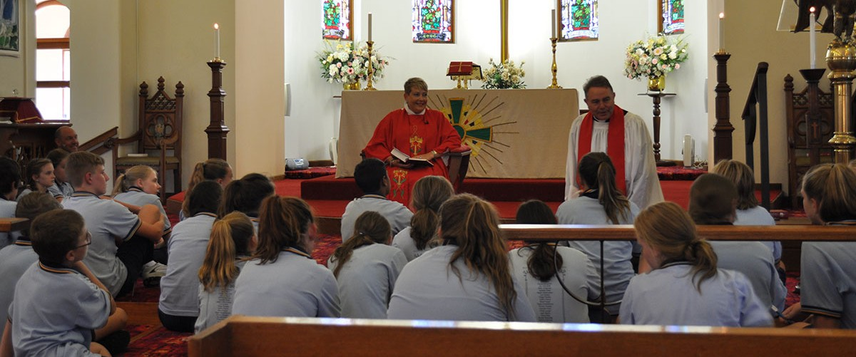 A group of high school students gather at St John's Anglican Church, Taree, as part of a day to support their transition into high school.
