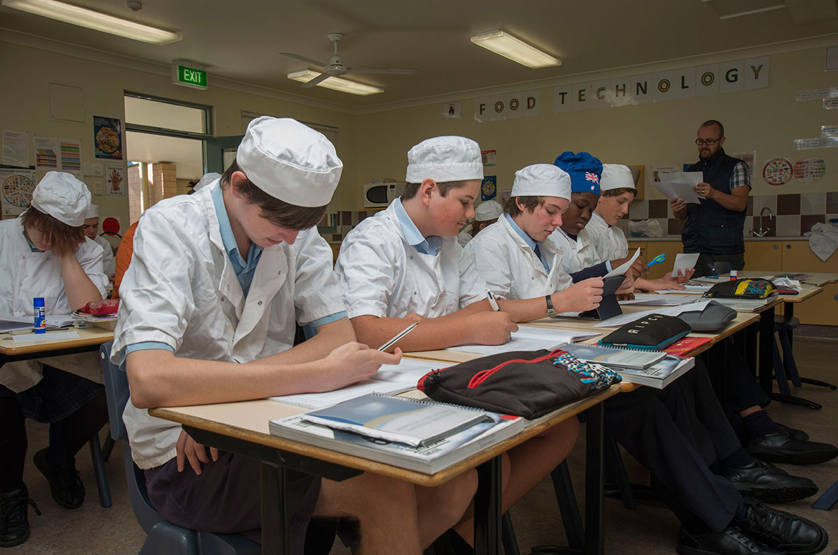 A group of students study food technology as part of the High School Curriculum