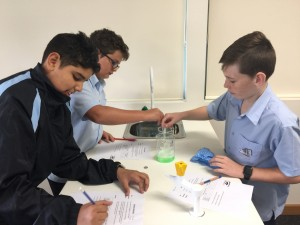 A group of secondary school students explore circuitry in science class